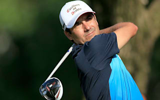 Ironman Aguilar leads as weather brings China Open to halt