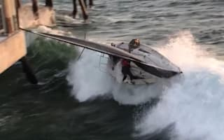 Sailing boat crashes into pier in strong winds