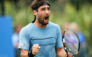 Cuevas, Baghdatis battle through to last eight