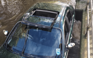 Cyclists rescue pensioners from flooded car