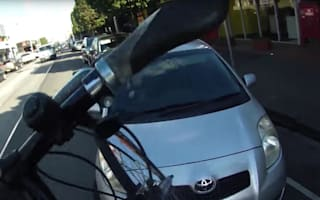 Cyclist screams at driver on the phone after close call