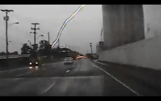 Police dashcam captures moment lightning strike hits house