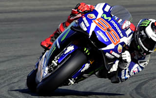 Lorenzo smashes lap record to claim Valencia pole