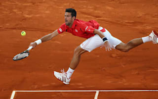 Djokovic sees off Raonic to reach Madrid semis