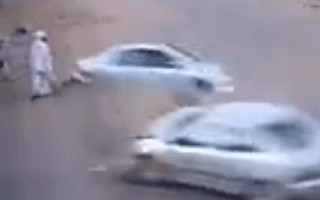 Video: Pedestrian narrowly avoids out-of-control car