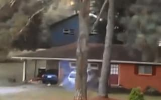 Video: Crazed man attempts to bulldoze own house with SUV