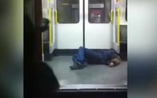 Video: 'Busy' commuters completely ignore man collapsed on train floor