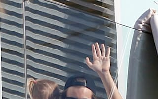 Harry Styles relaxes poolside at luxury hotel in Barcelona