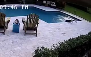 Girl falls off hoverboard, jumps into swimming pool to save it (video)