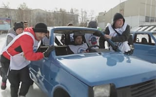 Car curling match held on Russian skating rink