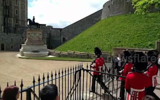 Queen's Guard shouts at eager tourist outside Windsor Castle
