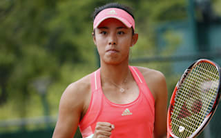 Wang advances in Dalian, injured Zhang out