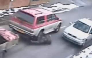 Car theft victim narrowly avoids being crushed against car