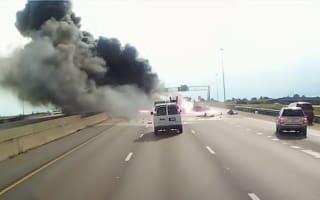 Video: Heroic trucker saves passengers from burning car