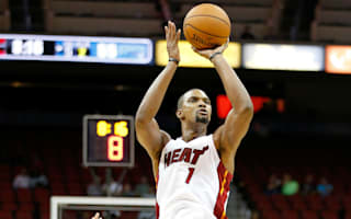 Bosh held out of practice, won't travel with Heat for Hawks game