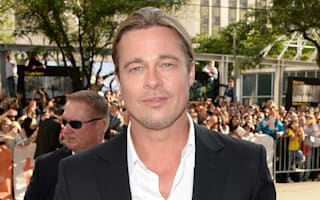 Wedding crasher! Brad Pitt causes a stir at five-star hotel reception in Buckinghamshire