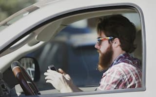 Drivers using phone behind the wheel face tougher fines