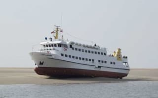 136 passengers stranded as cruise ship runs aground