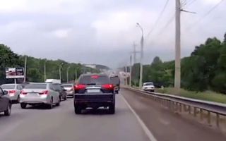 Impatient motorist hits the hard shoulder to overtake traffic