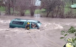 Elderly man rescued from car trapped in floodwater