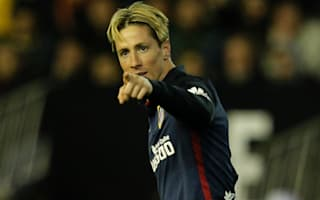 Atletico hero Torres refuses to give up title hopes