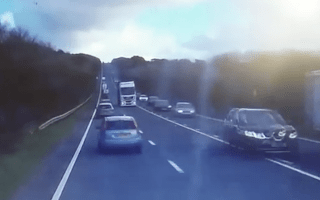 Shocking footage shows overtaking lorry causing havoc on busy road