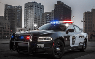 Canadian garage accused of drag racing police cars