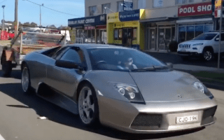 Lamborghini spotted towing trailer full of goats