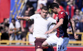 Bologna 0 Roma 3: Dzeko helps keep Juventus in sight