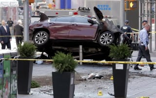 One dead as car hits pedestrians in New York's Times Square