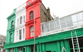 Council threatens colourful bar with court over paint job
