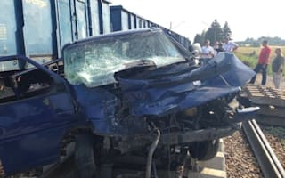 Hitch-hiker narrowly survives train impact