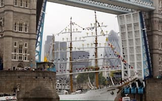 One of the world's tallest ships squeezes through Tower Bridge - just