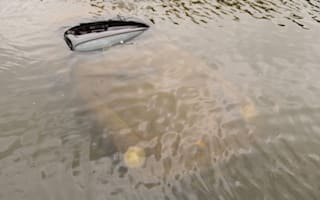 Driver rescued from sinking Porsche
