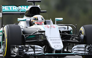 Hamilton sets Sepang record to take pole