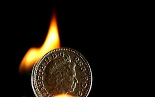 Sterling rocked by credit downgrade