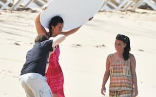 Coleen Rooney frolics for photo shoot on Barbados beach