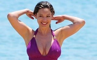 Gorgeous in Greece! Kelly Brook suns herself in a purple swimsuit