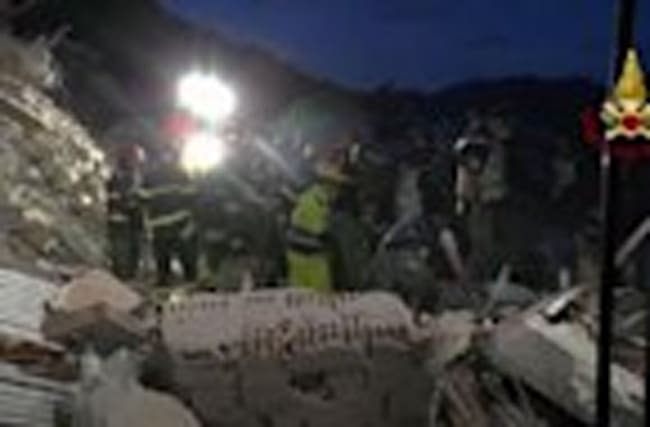 Raw: Italian Rescuers Pull Victim From Rubble