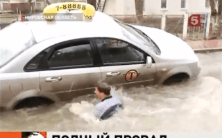 Video: Giant pothole eats taxi driver