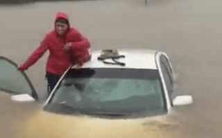 Rescuers save mother and child from Hurricane Matthew floods