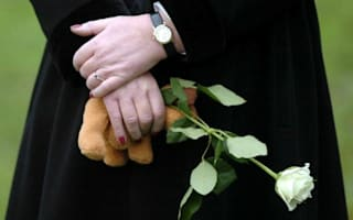 Widower ordered to remove garden next to wife's grave