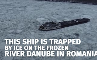 Cargo ship stranded in frozen River Danube