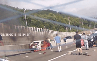 Heroic strangers rescue woman from burning car