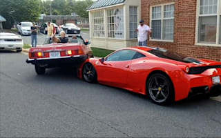 A driver reversed her classic Merc on to a Ferrari 458 Speciale