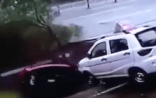 Four cars swallowed by 100ft sinkhole in China's Jiangxi Province
