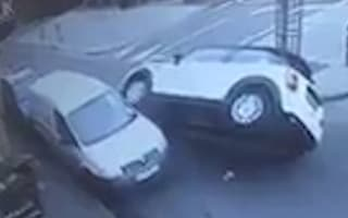 MINI nearly flips over after crashing into parked van