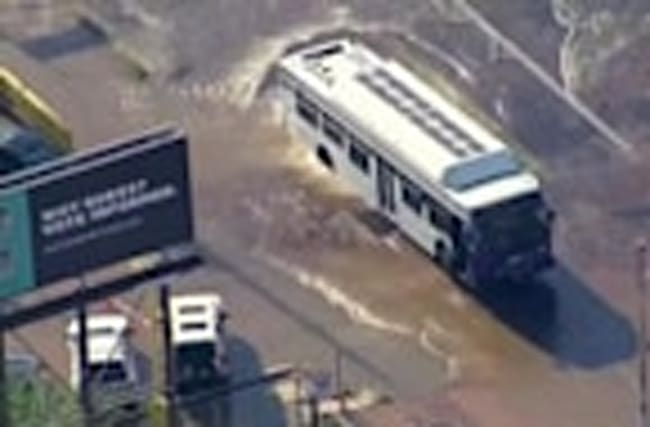 Phoenix bus trapped by giant sinkhole