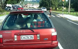 Motorist films kid driving car packed with children and goat