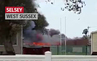 Major blaze at school as loud explosions reported